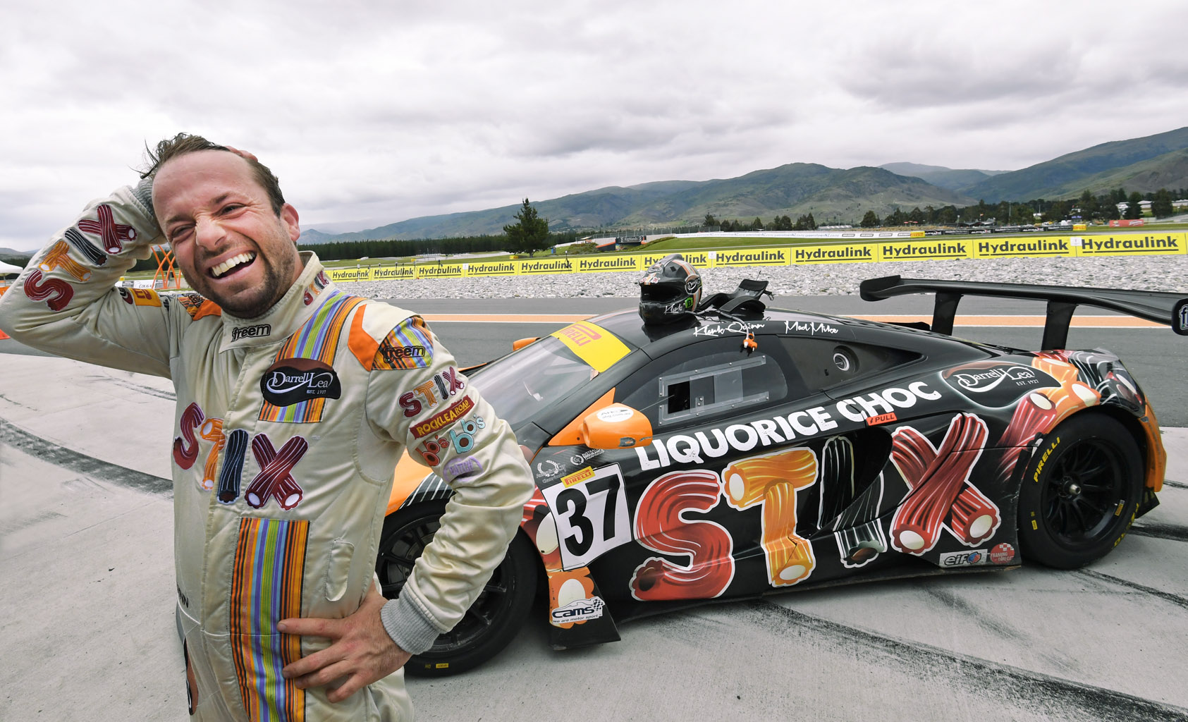 Klark Quinn celebrates his Australian GT Championship victory at Highlands